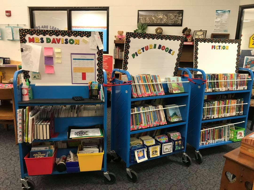 Three library carts with books